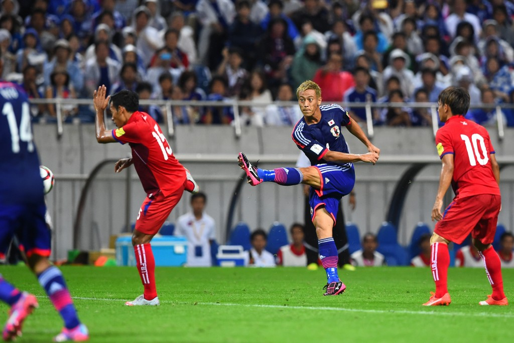 SAITAMA, JAPAN - SEPTEMBER 03:  Keisuke Honda of Japan scores Japan's 1st goal during the 2018 FIFA World Cup Qualifier Round 2 - Group E match between Japan and Cambodia at Saitama Stadium on September 3, 2015 in Saitama, Japan.  (Photo by Masterpress/Getty Images)