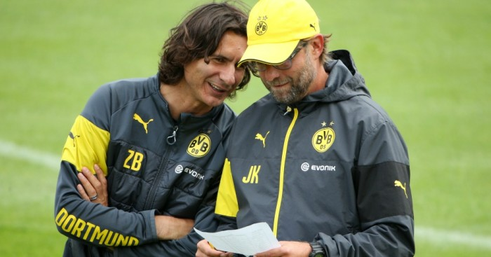 BAD RAGAZ, SWITZERLAND - JULY 30: Assistant coach Zeljko Buvac (L) speaks with head coach Juergen Klopp during the Borussia Dortmund training camp on July 30, 2014 in Bad Ragaz, Switzerland. (Photo by Philipp Schmidli/Bongarts/Getty Images)