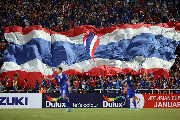 BANGKOK, THAILAND - DECEMBER 17: Thailand fans wave their national flag during the 2014 AFF Suzuki Cup final 1st leg match between Thailand and Malaysia at Rajamangala National Stadium on December 17, 2014 in Bangkok, Thailand. (Photo by Stanley Chou/Getty Images)
